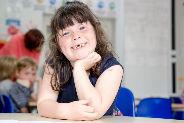 rhodes-avenue-photo-ks1-classroom-girl-at-desk-smiling-1